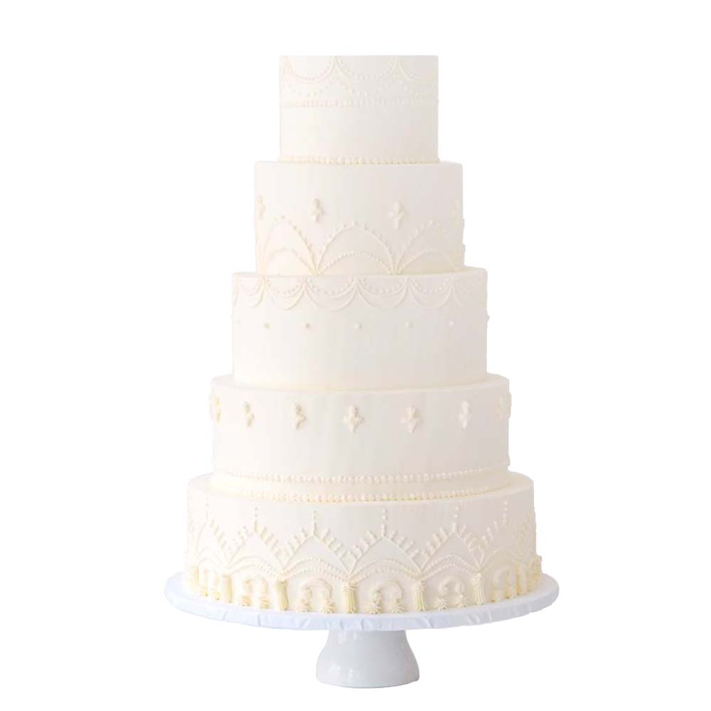 Elegant White Buttercream Wedding Cake with Piped Details