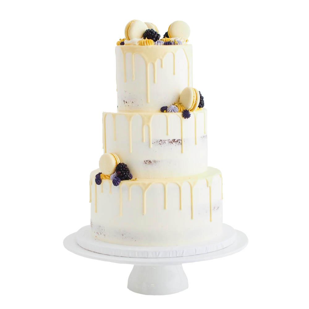 Yellow Drip Cake with Macarons